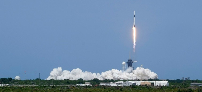 A SpaceX Falcon 9, with NASA astronauts Doug Hurley and Bob Behnken in the Crew Dragon capsule, lifts off from Pad 39-A at the Kennedy Space Center in Cape Canaveral, Fla., Saturday, May 30, 2020.