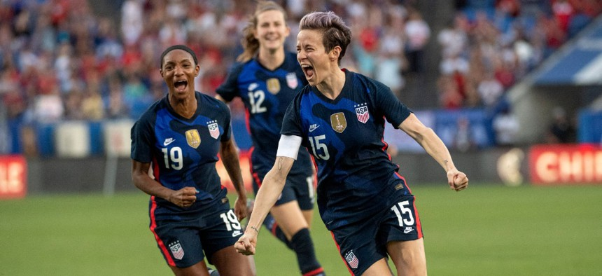 United States forward Megan Rapinoe (15) celebrates with defender Crystal Dunn (19) during a SheBelieves Cup women's soccer match March 11 in Frisco, Texas.