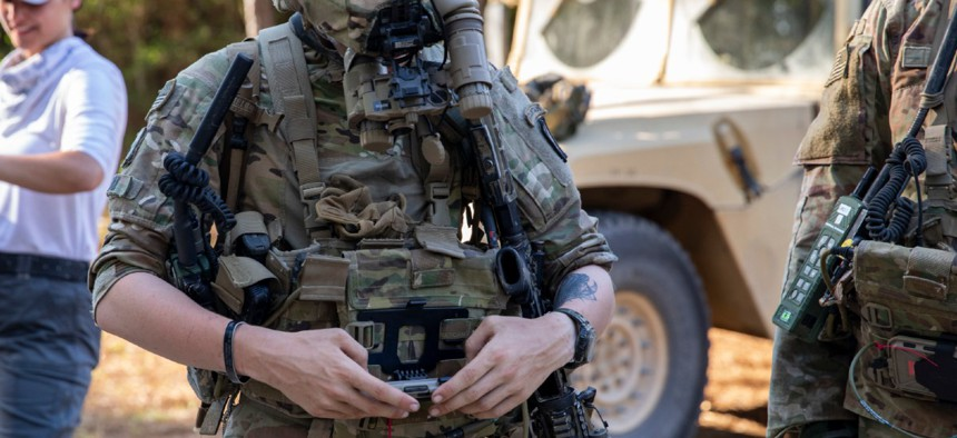 A cavalry scout uses an Android Tactical Assault Kit to plot waypoints during field testing of the enhanced night vision goggles-binoculars at Fort Polk, Louisiana, June 16.