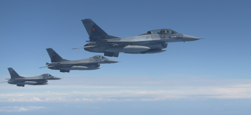 Three Romanian F-16s fly alongside a U.S. Air Force KC-135 Stratotanker assigned to the 100th Air Refueling Wing, England, over Romania July 22, 2020.