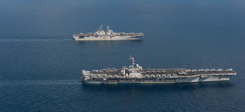 The aircraft carrier USS Dwight D. Eisenhower (CVN 69), front, the amphibious assault ship USS Bataan (LHD 5) and the amphibious transport dock ship USS New York (LPD 21) transit the Arabian Sea, April 2, 2020.