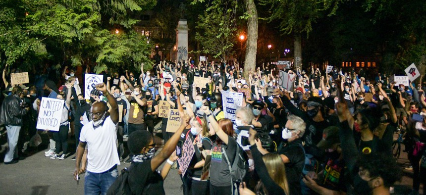 Black Lives Matter protest peacefully after federal officers scale back at Mark O. Hatfield United States Court House in Portland, Oregon on August 1.