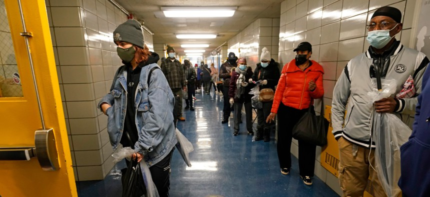 Voters wait in line in a hallway at Harlem's P.S. 175 on the last day of early voting Nov. 1, 2020, in New York.