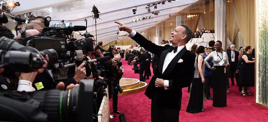 Tom Hanks arrives at the Oscars in Los Angeles on Feb. 9, 2020. Last March, Hanks disclosed that he had tested positive for the coronavirus while filming in Australia.