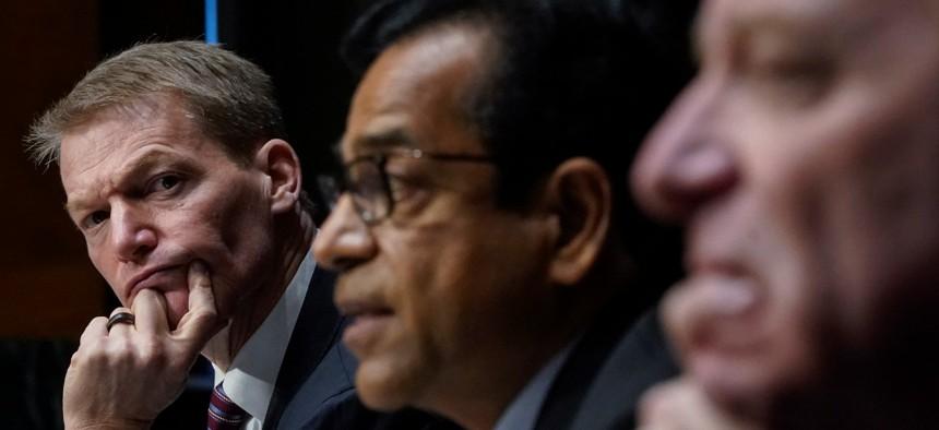 FireEye CEO Kevin Mandia, SolarWinds CEO Sudhakar Ramakrishna and Microsoft President Brad Smith testify during a Senate Intelligence Committee hearing Feb. 23.