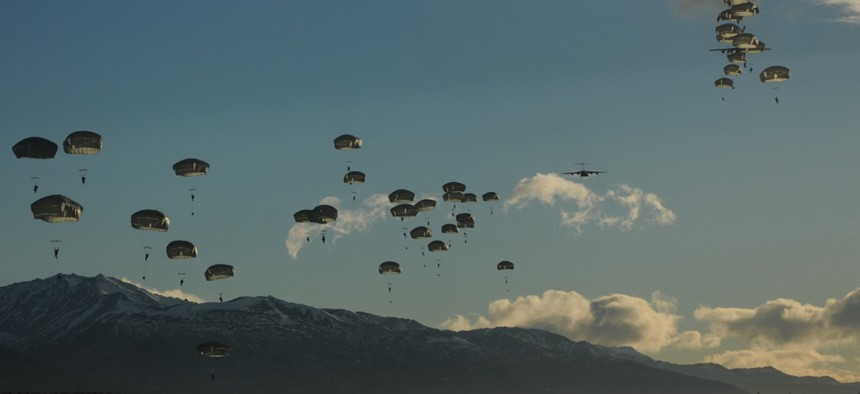 Paratroopers exit from two Air Force C-17 Globemaster III aircraft during an airborne operation on the first day of a nine-day field training exercise in 2014 at Joint Base Elmendorf-Richardson, Alaska.