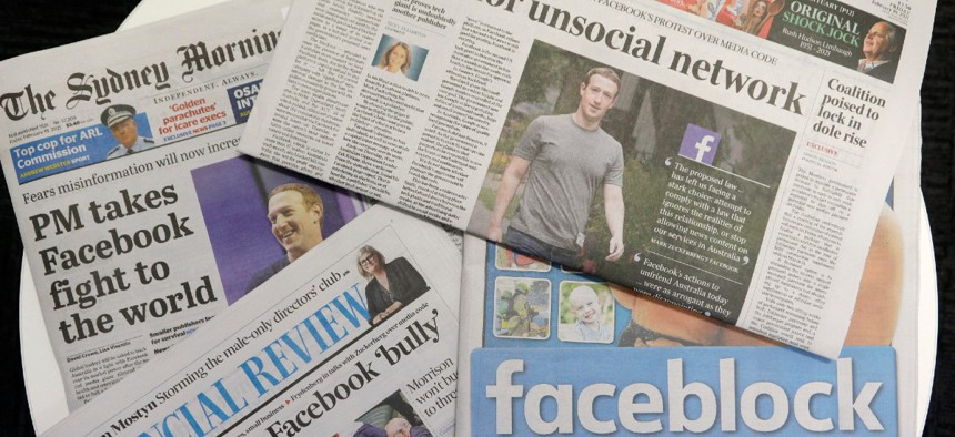 Front pages of Australian newspapers are displayed featuring stories about Facebook in Sydney Feb. 19.