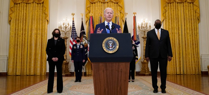 President Joe Biden speaks during an event to mark International Women's Day March 8 in the East Room of the White House.