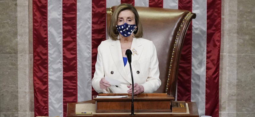 Speaker of the House Nancy Pelosi, D-Calif., leads the vote to approve a landmark $1.9 trillion COVID-19 relief bill, at the Capitol in Washington, Wednesday, March 10, 2021.