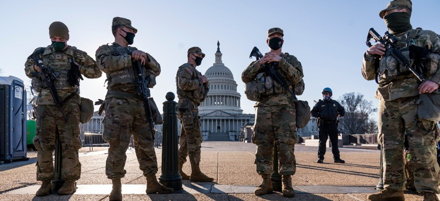 Members of the Michigan National Guard and the U.S. Capitol Police keep watch as heightened security remains in effect around the Capitol grounds since the Jan. 6 attacks by a mob of supporters of then-President Donald Trump.