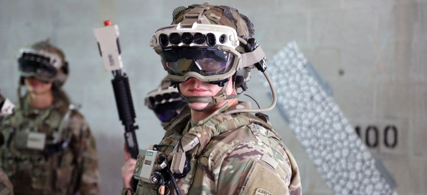 Soldiers wear a militarized form factor prototype of the Army's Integrated Visual Augmentation System and wield a Squad immersive Virtual Trainer during a training environment test event at its third Soldier Touchpoint at Fort Pickett, Virginia in 2020..
