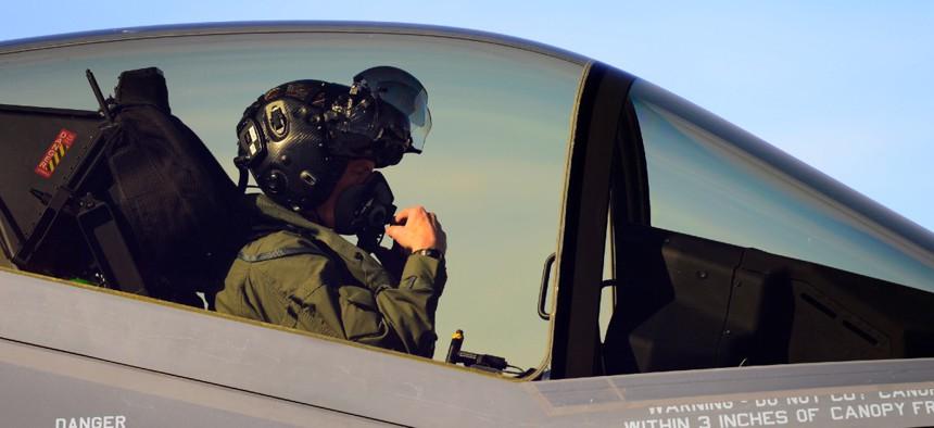 A test pilot goes through his pre-flight checks before flying an F-35A at Hill Air Force Base, Utah.