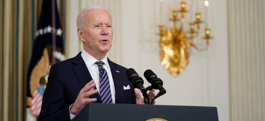 President Biden speaks about the COVID-19 relief package in the State Dining Room of the White House on March 15.