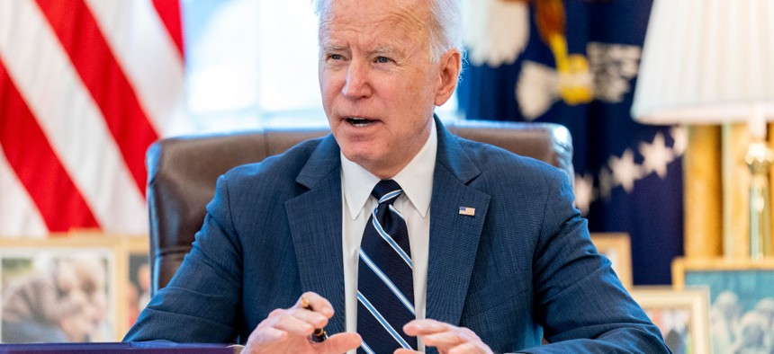 President Joe Biden speaks before signing the American Rescue Plan, a coronavirus relief package, in the Oval Office of the White House on March 11.