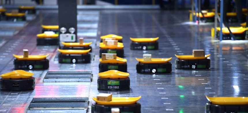 Robots work at a warehouse in China's Anhui province.