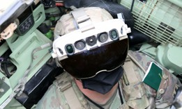 Soldier dons the Integrated Visual Augmentation System Capability Set 3 hardware while mounted on a Bradley in Joint Base Lewis-McCord.