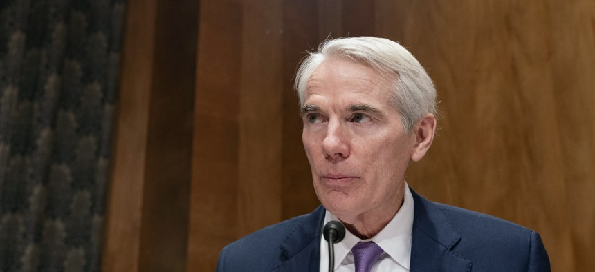 Sen. Rob Portman R-Ohio, speaks during a Senate Homeland and Governmental Affairs Committee hearing to examine improving Federal cybersecurity, Tuesday, May 11, 2021 on Capitol Hill in Washington.
