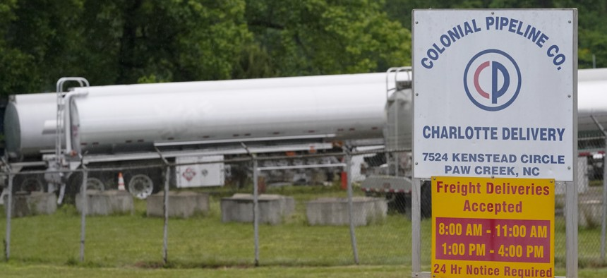 Tanker trucks are parked near the entrance of Colonial Pipeline Company Wednesday, May 12, 2021, in Charlotte, N.C. The operator of the nation's largest fuel pipeline has confirmed it paid $4.4 million to a gang of hackers who broke into its computer systems. That's according to a report from the Wall Street Journal. Colonial Pipeline's CEO Joseph Blount told the Journal that he authorized the payment after the ransomware attack because the company didn't know the extent of the damage