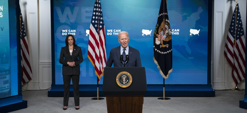 Vice President Kamala Harris listens as President Joe Biden speaks about the COVID-19 vaccination program, in the South Court Auditorium on the White House campus, Wednesday, June 2, 2021, in Washington