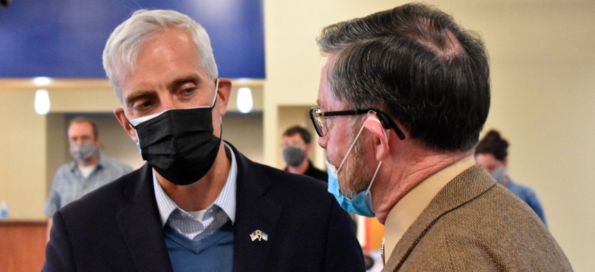 Secretary of Veterans Affairs Denis McDonough, left, speaks with retired Lt. Col. Ed Saunders at a listening session for veterans at Montana State University-Billings in April.