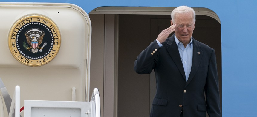 President Joe Biden salutes as he boards Air Force One upon departure, Wednesday, June 9, 2021, at Andrews Air Force Base, Md. Biden is embarking on the first overseas trip of his term, and is eager to reassert the United States on the world stage, steadying European allies deeply shaken by his predecessor and pushing democracy as the only bulwark to the rising forces of authoritarianism.