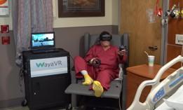 Veteran enjoys virtual activity to distract from post-operative pain.