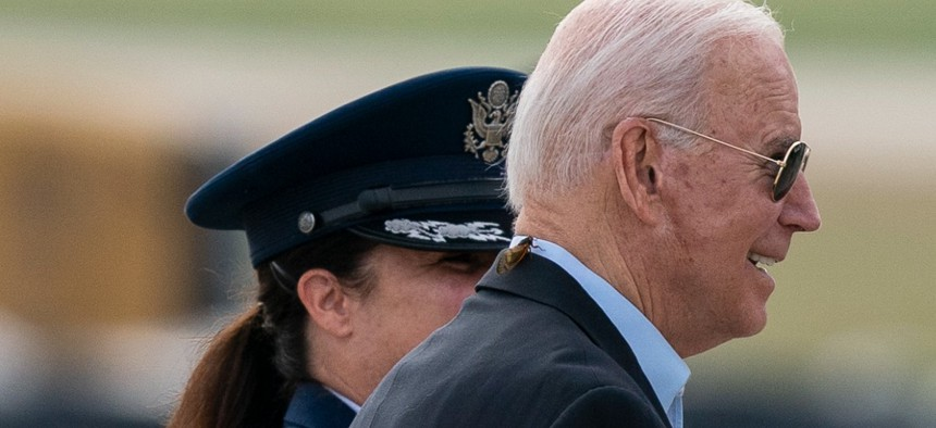 President Joe Biden, with a brood X cicada on his back, walks to board Air Force One upon departure, Wednesday, June 9, 2021, at Andrews Air Force Base, Md.