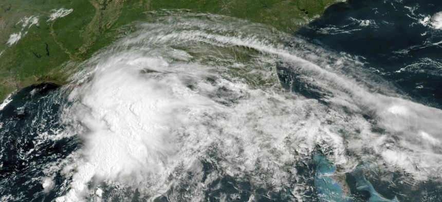 This GOES-16 GeoColor satellite image taken Friday, June 18, 2021, at 11 a.m. EDT, and provided by NOAA, shows a tropical weather system in the Gulf of Mexico.