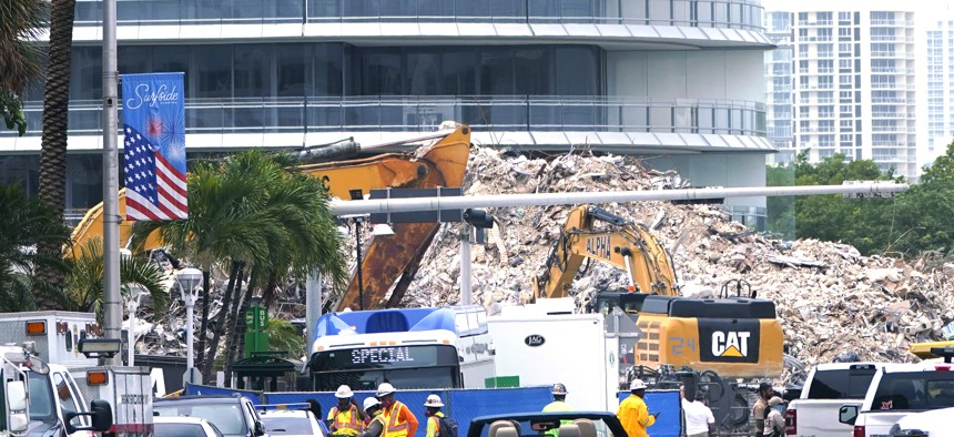 Crews work in the rubble of the Champlain Towers South building, as removal and recovery work continues at the site of the partially collapsed condo building, Tuesday, July 13, 2021, in Surfside, Fla.