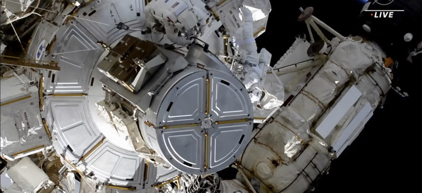 This photo provided by NASA shows astronauts NASA's Shane Kimbrough and France's Thomas Pesquet during a space walk outside the International Space Station on Friday, June 25, 2021. The astronauts are working to install another new solar panel outside the station.