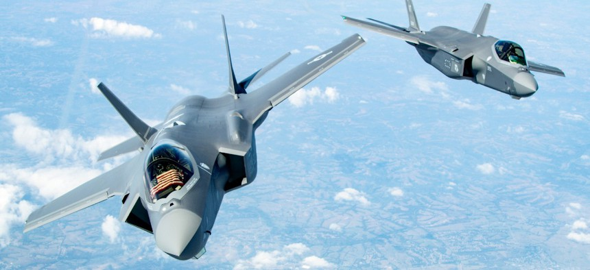 Two F-35 Lightning II's bank after receiving fuel over the Midwest Sept. 19, 2019.