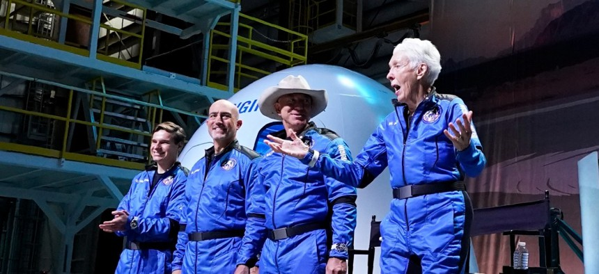 Oliver Daemen, Mark Bezos, Jeff Bezos and Wally Funk, right, discussed their flight experience aboard the Blue Origin New Shepard rocket at its spaceport near Van Horn, Texas, July 20.