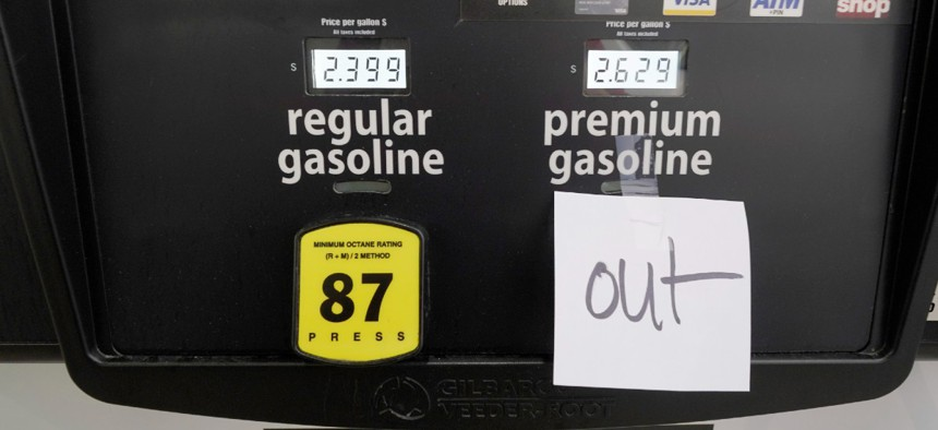 A note posted at a gas pump indicates the pump is out of premium gasoline at a Costco Warehouse fuel station, Tuesday, May 11, 2021, in Ridgeland, Miss.