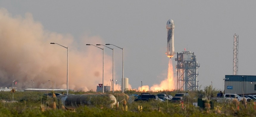 Blue Origin's New Shepard rocket launches carrying founder of Amazon and space tourism company Blue Origin Jeff Bezos and crew from its spaceport near Van Horn, Texas, on July 20.