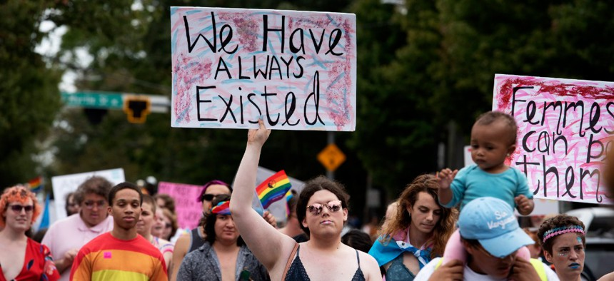 Transgender and non-binary individuals and their allies stroll through the city's Midtown district during Gay Pride's Transgender Rights march in Atlanta on Oct. 12.