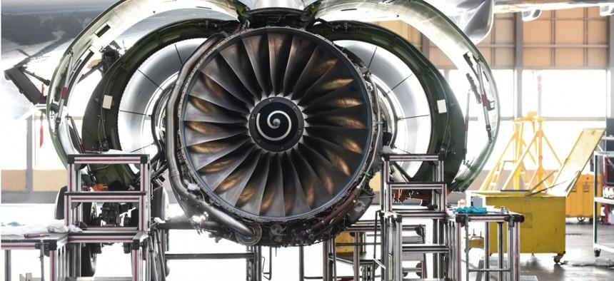 Aircraft Jet engine maintenance in airplane hangar
