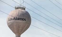 Los Alamos, USA - June 17, 2019: City in New Mexico with view of water tower tank on road with sign for National Laboratory