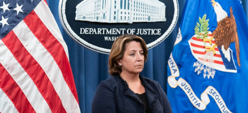 Deputy Attorney General Lisa Monaco stands during a news conference at the Department of Justice, Thursday, Sept. 30, 2021, in Washington.