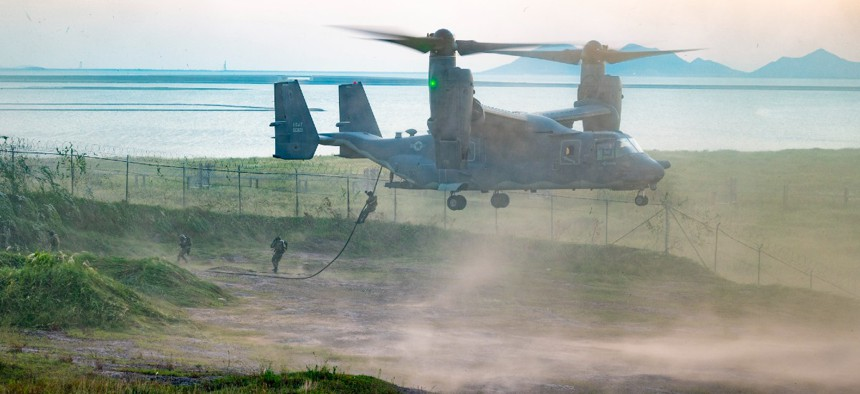 Air Force Special Tactics airmen fast rope from a CV-22 Osprey during Teak Knife training at Kunsan Air Base, Republic of Korea, Sept. 9.