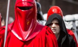 """""""Star Wars"""" fans dressed as the Imperial Guard and the Emperor—a Sith lord—walk in parade in the streets of Rome in 2014."""