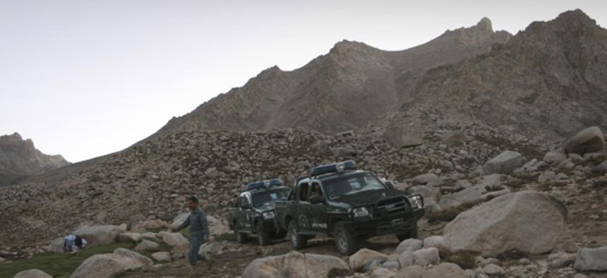 Afghan police patrol mountains outside Kabul.