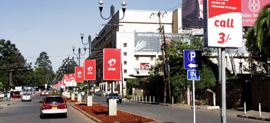 Nairobi streets are adorned with mobile phone ads.