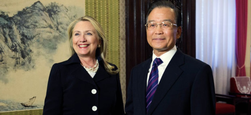 Hillary Rodham Clinton, left, shakes hands with Chinese Premier Wen Jiabao during a bilateral meeting at the Zhongnanhai leadership compound in Beijing Wednesday.