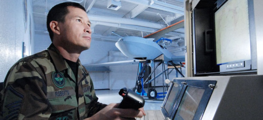 Master Sgt. Fred Roberts uses a maintenance interface station to check an MQ-1 Predator unmanned aircraft.