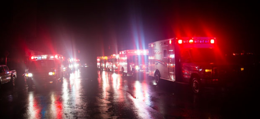 Ambulances wait outside New York University Tisch Hospital during the storm.