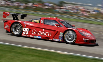 A car drives through the seventh turn during the Rolex Grand Am race at the Indianapolis Motor Speedway.