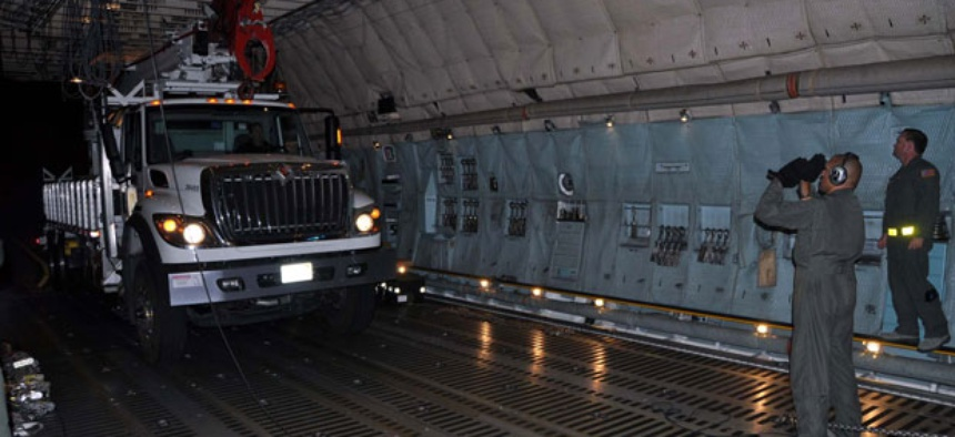 Reservists and technicians from March Air Reserve Base, Calif., load electrical equipment into a transport aircraft to send to the East Coast after the storm.