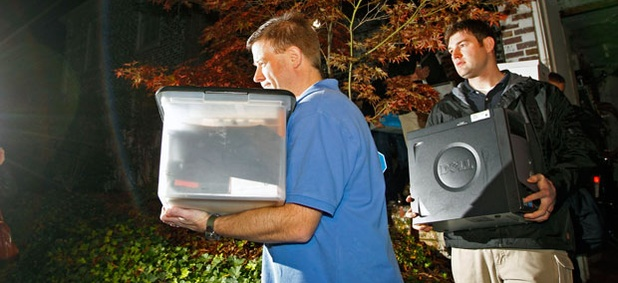 FBI agents carry computers and boxes of printed documents from Paula Broadwell's home Tuesday.