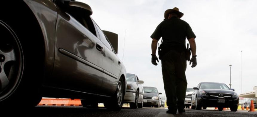 A CBP agent checks traffic leaving the U.S. for Mexico in Laredo, Texas.