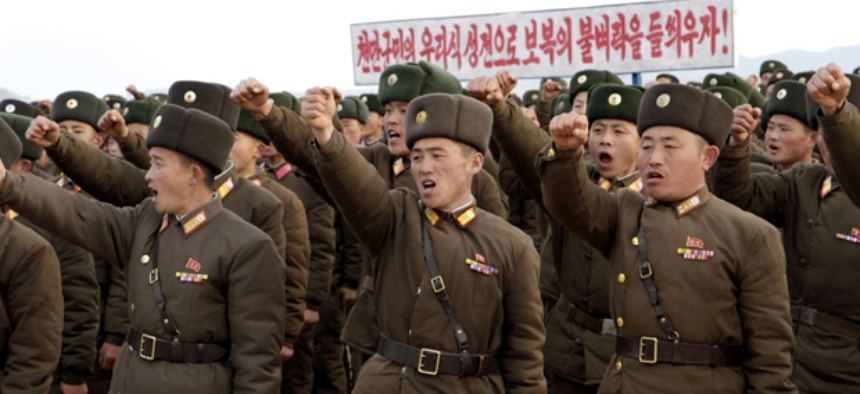 In this Nov. 23, 2012 photo, North Korean soldiers vow to retaliate against any South Korean military action during a rally in South Hwanghae Province.